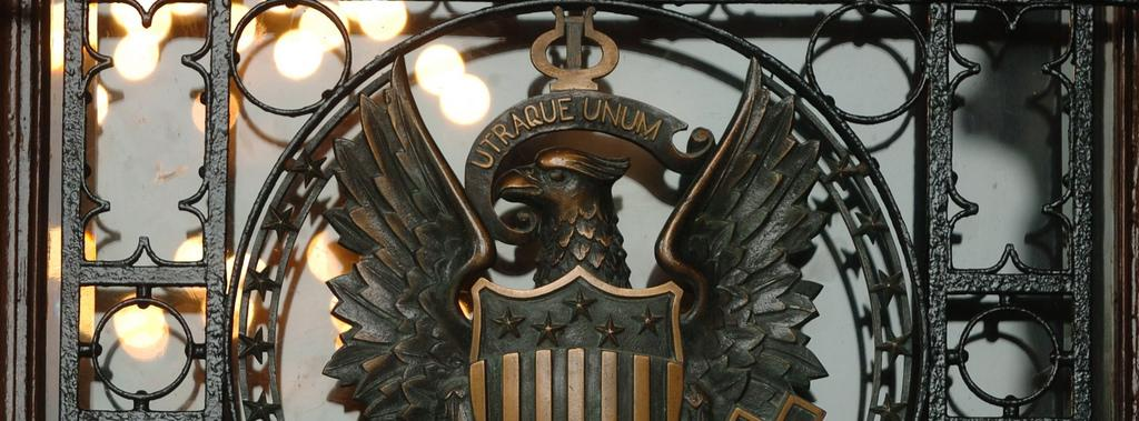 Close-up of the eagle and shield that adorn the Healy Hall gate